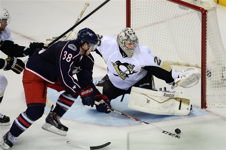 Fleury makes a save Penguins goalie Marc-Andre Fleury makes a save on the Blue Jackets Boone Jenner in the third period Monday night in Columbus,