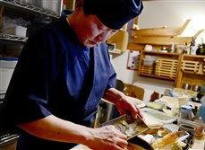 "Fumio ""Yasu"" Yasuzawa  puts the finishing touches on a bowl of Udon Noodles at Chaya in Squirrel Hill."