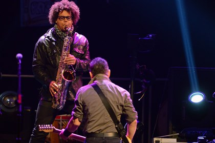 20140422bwBruceMag09-2 Jake Clemons on sax with Bruce Springsteen and the E Street Band, performing at Consol Energy Center.