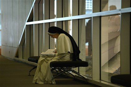 20140422dsCatnEdLocal08 Sister Cecilia Anne finds a quiet moment to get ready at The National Catholic Education Convention held at the David L. Lawrence Convention Center.