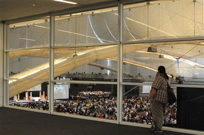 20140422dsNatCathLocal9-3 Don Blackbird Jr. a principal at St. Augustine's in Winnebago , Neb. watches Mass from the third floor level at the David L. Lawrence Convention Center. He was attending the National Catholic Education Convention.