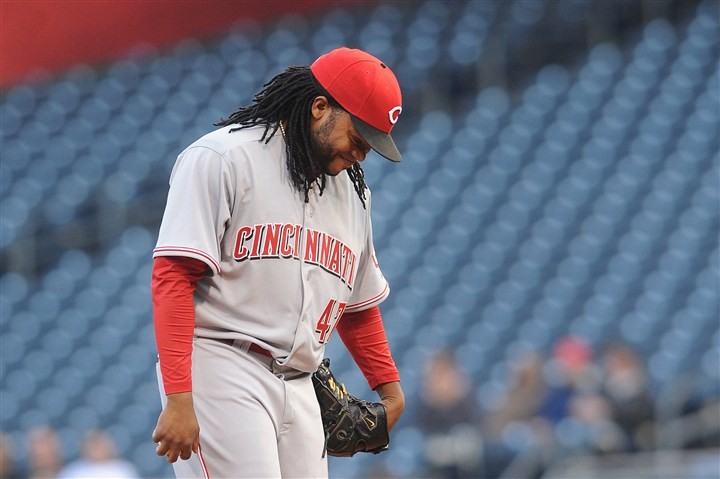 Cincinnati Reds' Johnny Cueto Reds pitcher Johnny Cueto laughs last night as the PNC Park crowd calls his name. During a playoff game last season, crowd noise caused him to drop the baseball.