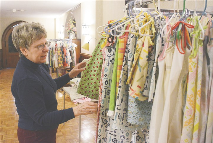 20140422DressNorth01 Mary Ellen Kirby, member of Third Presbyterian Church, unpacks dresses at the church in Shadyside on Tuesday.