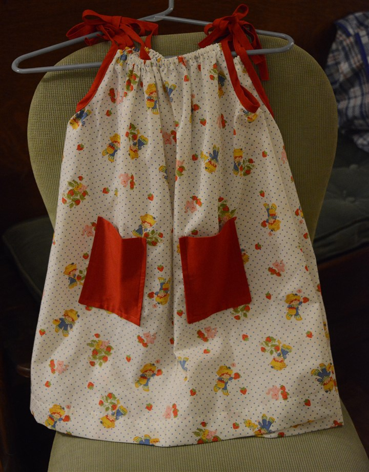 "20140422DressNorth02-1 Volunteers from about 25 churches -- many in the North Hills -- have been making little skirts, shorts and tops for children in Africa. The final products are being gathered this week in the ""Little Dresses for Africa"" program."