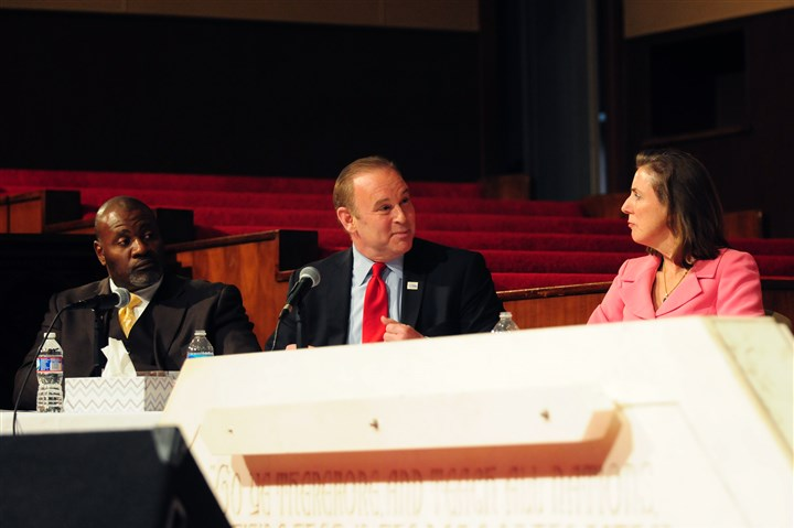 20140422GovDebateLocal001 Democratic gubernatorial candidates Rob McCord and Katie McGinty exchange words during a debate at the Central Baptist Church in the Hill District. At left is state senator Jake Wheatley representing gubernatorial candidate Tom Wolf.