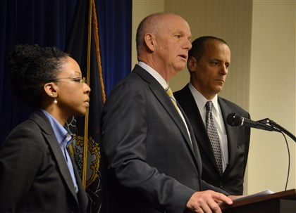 20140423lfIdentityLocal01-1 United States Attorney David Hickton, center, talks to the media while Akeia P. Conner, left, IRS criminal investigation special agent in charge, and Patrick Fallon, FBI assistant special agent in charge, listen during a news conference at the Federal Courthouse.