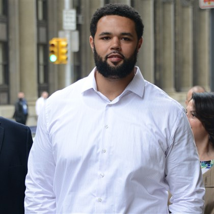 20140423lfTrialLocal02-4 Steelers player Mike Adams arrives Wednesday at the Allegheny County Courthouse to testifying against the three men accused of stabbing him last year on the South Side.