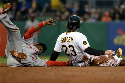 20140423mfbucssports06-3 The Reds' Brandon Phillips tags out the Pirates' Travis Snider at second base in the third inning Wednesday night at PNC Park.