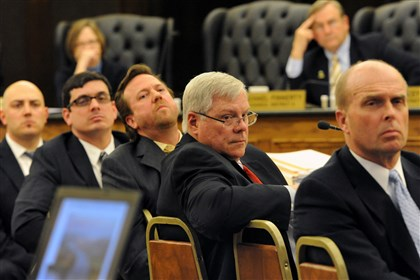 Deer Lakes drilling John Applegath, senior vice president for the Southern Marcellus Shale division for Range Resources, second from right, and other representatives from Range Resources watch the slide show of the company's plan for drilling beneath Deer Lakes Park during a meeting Wednesday night of the Allegheny County Council's parks committee.