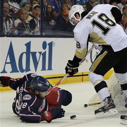 20140423pdPenguinsSports05 James Neal battles Columbus' David Savard for the puck at Nationwide Arena in Columbus.