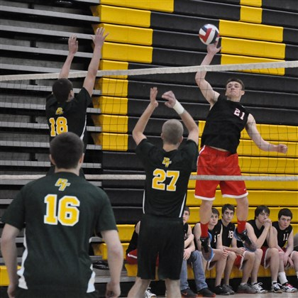 20140421hoZSpoVolleyball01.jpg Upper St. Clair's Garrett O'Grady leaps high to return a shot against Penn-Trafford during action at the North Allegheny Tournament as teammate.