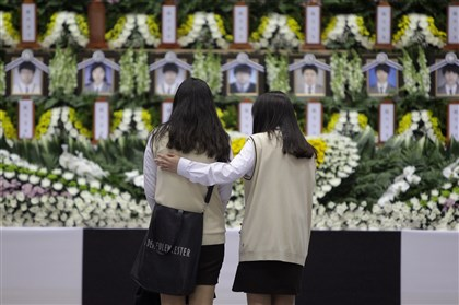 486181237 Students from Danwon high school pay tribute at a group memorial altar for victims of sunken passengers ship at the Ansan Olympic Memorial Hall on Wednesday in Ansan, South Korea.