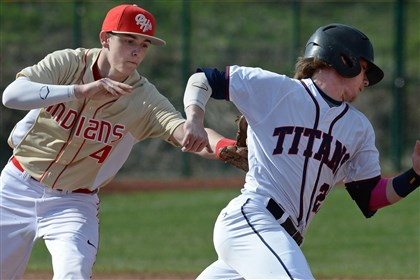 20140409mfshalersports03.jpg Penn Hills' Zac Crosmun tags out Shaler's Andrew Mueller between first and second bases during a rundown play in a game earlier this month.