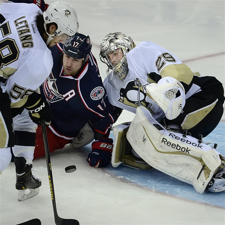 20140423pdPenguinsSports07 Marc-Andre Fleury makes a save on the Blue Jackets' Brandon Dubinsky in Game 4 Wednesday.