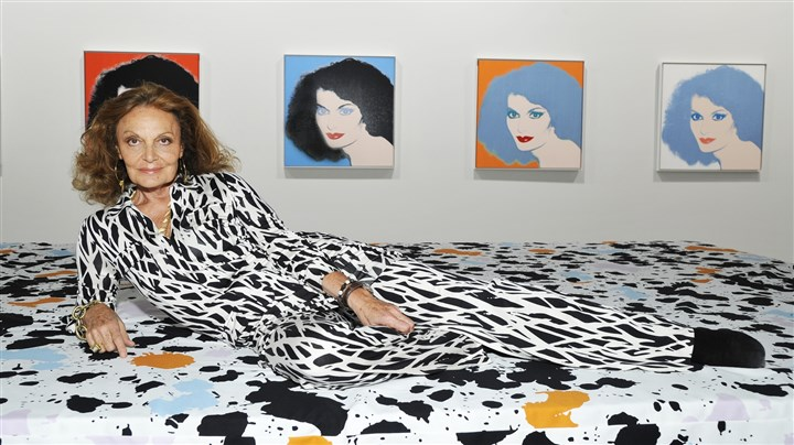 Diane von Furstenberg with Andy Warhol paintings Designer Diane von Furstenberg, celebrated for popularizing the modern wrap dress, poses next to paintings of her by Andy Warhol.
