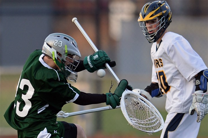 20140414mfmarssports02.jpg Pine-Richland's Zach Skirpan makes a save in front of Mars' Blake Thompson during the Rams' 7-6 victory on April 14.
