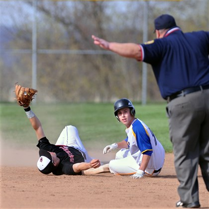 rooney0425 Upper St. Clair second baseman Gannon Rooney holds his glove up as Canon-McMillan's Dustin Bernardi looks to the umpire for the call on a steal Thursday in Canonsburg.