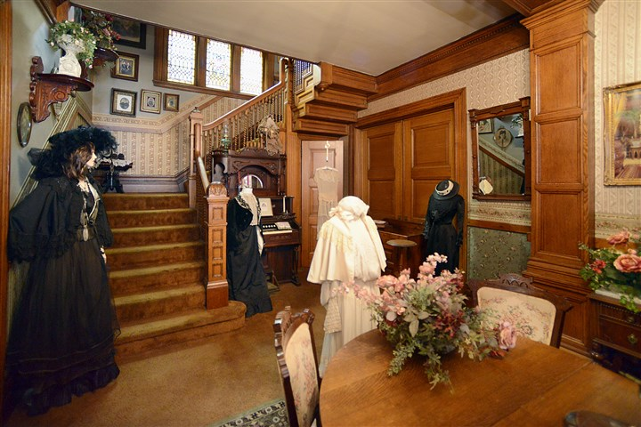 20140424radNewBrightonHouseMag03-17 In the front hallway, the intricate work of the newel posts, spindles and balustrade of the main staircase showcases the fine craftsmanship of the Victorian-style home. Top right: Wrap-around front porch.