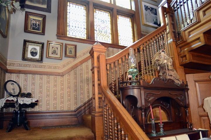 20140424radNewBrightonHouseMag06-20 The main staircase showcases a stained-glass window made of six panels with an arched piece on top.