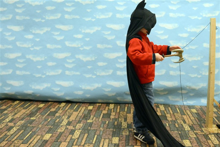 Avonworth gallery 2 Drew Brady, 3, dons a Batman costume as part of an exhibit.