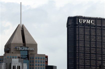 9et00klo-1 The Fifth Avenue Place headquarters of Highmark seen with the U.S. Steel Tower offices of UPMC in Downtown Pittsburgh.