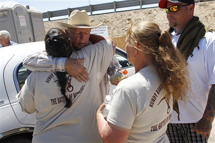 Range Showdown Racist Comments Rancher Cliven Bundy, second from left, hugs a supporter before holding a news conference near Bunkerville, Nev., Thursday.