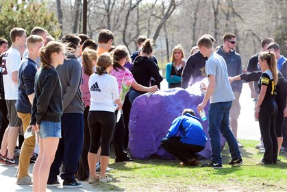 Connecticut School Stabbing Students spray paint a rock purple outside Jonathan Law High School in Milford, Conn., Friday in memory of 16-year-old stabbing victim Maren Sanchez.