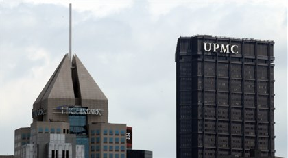 9et00klo-1 The Fifth Avenue Place headquarters of Highmark in view with the U.S. Steel Tower offices of UPMC.