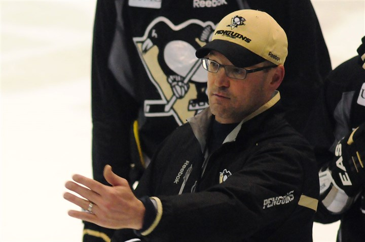Penguins coach Dan Bylsma Penguins coach Dan Bylsma speaks to players during the Penguins practice at Southpointe yesterday