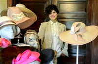 Pittsburgh-based milliner Gina Mazzotta at her home in Baden with a selection of her hat designs.