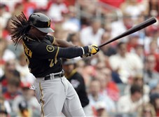 The Pirates' Andrew McCutchen follows through on an RBI single in the fourth inning against the St. Louis Cardinals on April 26, 2014, in St. Louis.