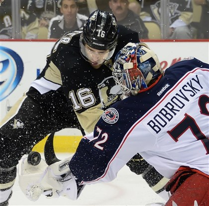 20140426pdPenguinsSports11-5 Blue Jackets goalie Sergei Bobrovsky makes a save on the Penguins' Brandon Sutter Saturday in Game 5 at Consol Energy Center.