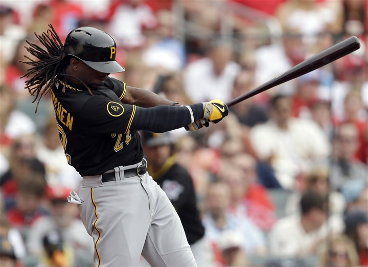 Pirates' Andrew McCutchen Andrew McCutchen follows through on an RBI single during the fourth inning against the Cardinals in St. Louis.
