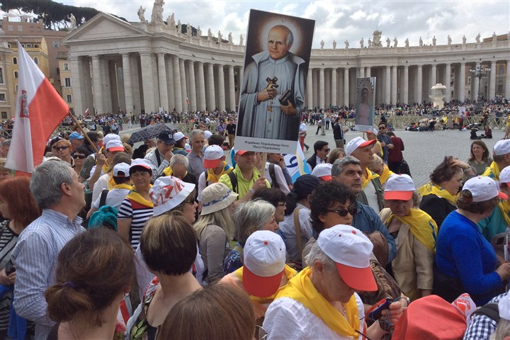 Canonization of popes, crowd gathers The Roman Catholic faithful gather at the Vatican in anticipation of the canonizing of Pope John Paul II and predecessor John XXIII.