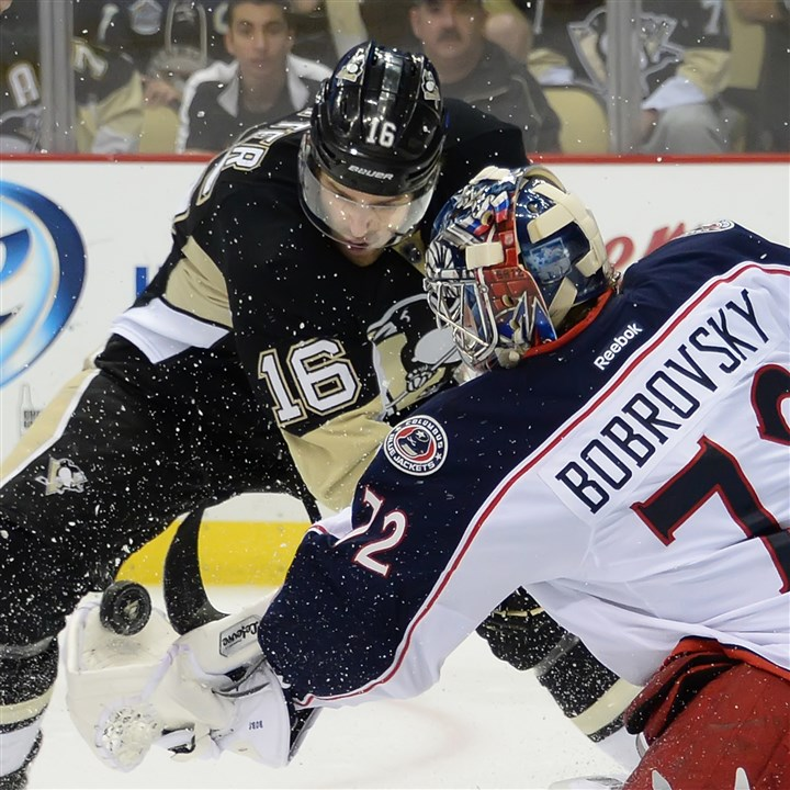 20140426pdPenguinsSports11-5 Blue Jackets goalie Sergei Bobrovsky makes save on the Penguins Brandon Sutter Saturday at the Consol Energy Center.