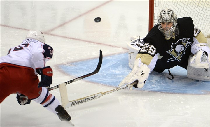 Marc-Andre Fleury makes a save  Marc-Andre Fleury makes a save on Blue Jackets' Cam Atkinson in the second period at Consol Energy Center Saturday night.