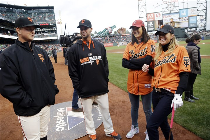Giant Fans San Francisco Giants pitchers Matt Cain, left, and Ryan Vogelsong talk with LPGA golfers Paula Creamer, right, and Michelle Wie Friday night at AT&T Park. Creamer and Wie were on hand as part of a promotional appearance tied in with the Swinging Skirts LPGA Classic in Daly City, Calif.