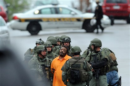 20140428MWHswatLocal01 Police take Lonnie Wade, 33, into custody after a standoff on Termon Avenue in Brighton Heights.