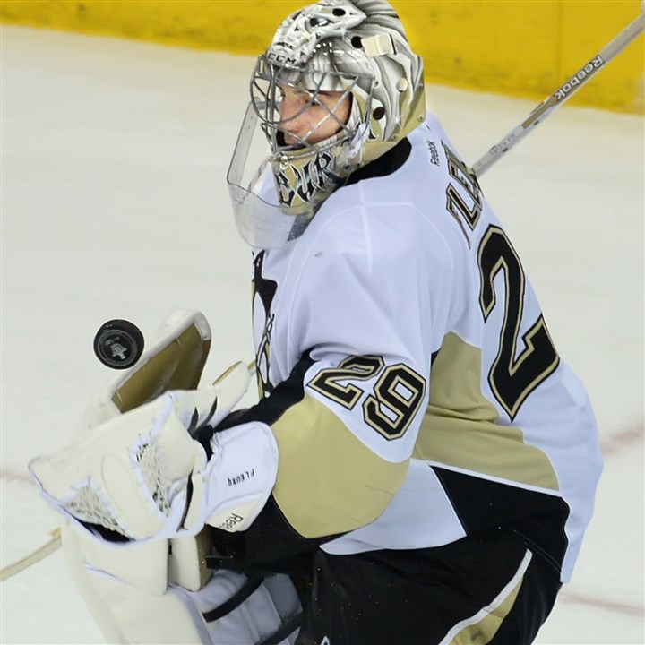 20140428pdPenguinsSports11-1 Penguins goalie Marc-Andre Fleury makes save against the Blue Jackets.