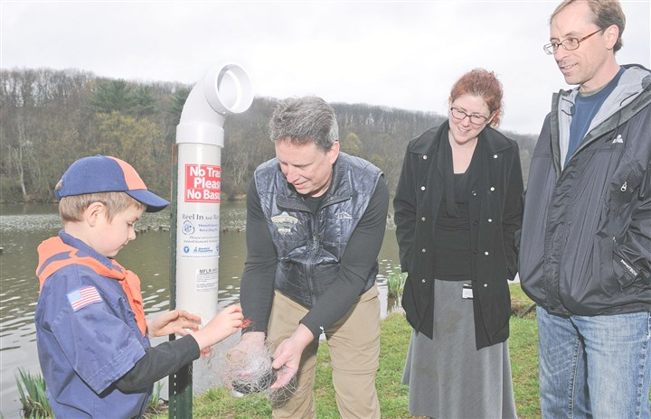 20140428JHNorthContainer01-1 Logan Southwick, 7, left, Robert Habegger, Dawn Miller (Logan's mom), and Eric Filo, right, with new container at North Park Lake.
