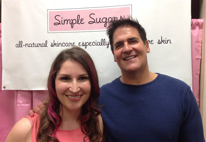 "20140428stylebooksanap Lani Lazzari, owner of Simple Sugars, a company that makes all-natural body and face scrubs, and Mark Cuban, owner of the Dallas Mavericks, stand at the Simple Sugars headquarters in Sharpsburg. Mr. Cuban invested in Ms. Lazzari's business when she appeared on the ABC reality TV show ""Shark Tank."""