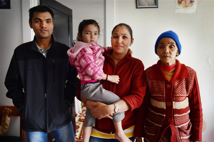 Poudel family Kul Bahadur Poudel, left, stands with his wife, Ishori, center, daughter Perika and mother, Bishnu Maya Poudel. They moved in with his brother's family today after the Allegheny County Health Department issued an order to vacate their nearby apartment. Now eight people will share a two-bedroom apartment until other arrangements can be made.