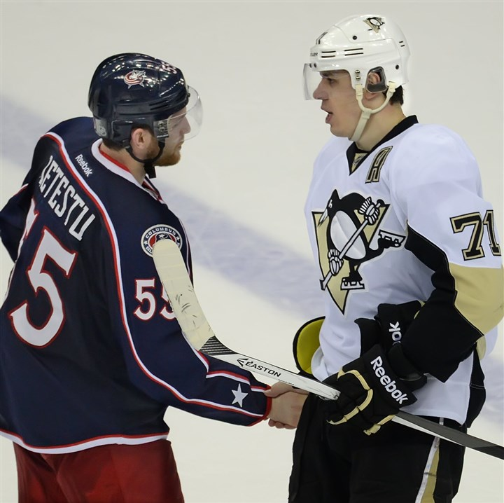 20140428pdPenguinsSports07-1 The Penguins' Evgeni Malkin shakes hands with the Blue Jackets' Mark Letestu at Nationwide Arena.