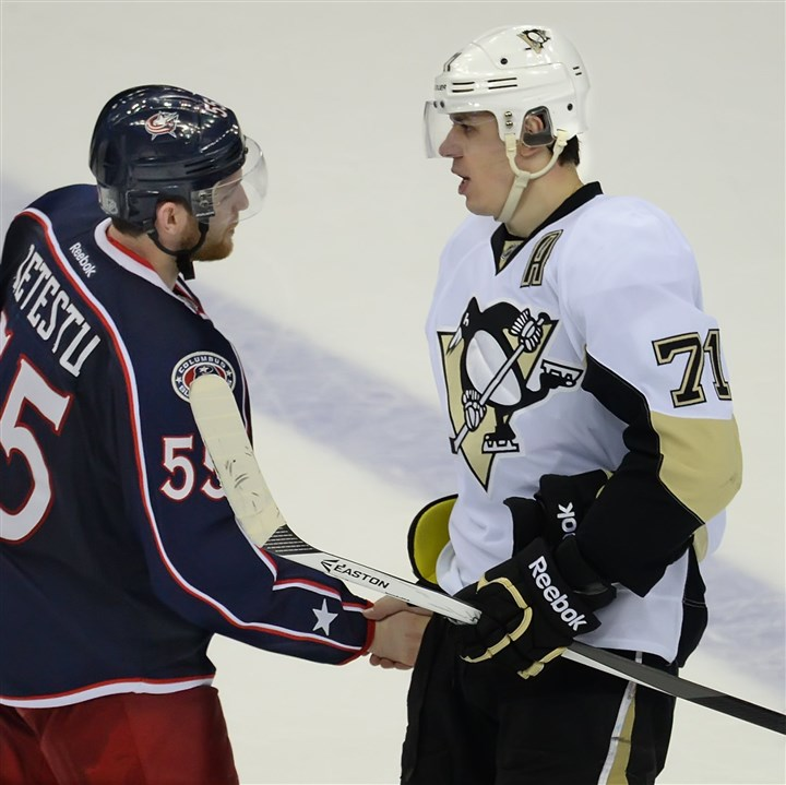 malkin0430 Game 6 hero Evgeni Malkin, right, shakes hands with Columbus' Mark Letestu during the traditional post-series handshake Monday in Columbus, Ohio.