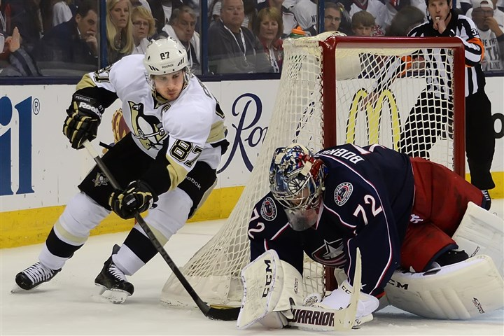 20140428pdPenguinsSports14 Blue Jackets goalie Sergei Bobrovsky makes save on the Penguins Sidney Crosby on Monday at the Nationwide Arena in Columbus, Ohio.