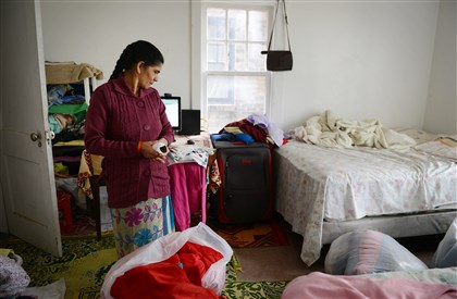 Madhabi Adhikari Madhabi Adhikari, 45, surveys her bedroom, where she has begun packing clothes into plastic bags for fear that she will have to move out of her apartment. Her landlord, Davin Gartley, was responsible for Berg Place, which the county health department issued an order to vacate earlier this month.