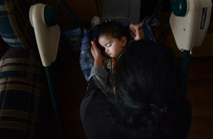 201400428jrCarrickfollowLocal1 Prashant Poudyel's mother puts him to sleep in a baby swing Monday, April 28 at home in Carrick.