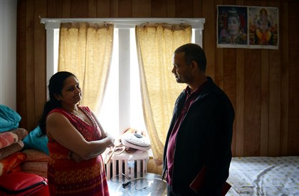 201400428jrCarrickfollowLocal6-5 Indira Dhaurali, 36, talks with Rup Pokhrel, an advocate and social worker with the Bhutanese refugee community in Pittsburgh, about some of the issues she has had with her apartment, Monday, April 28 in Carrick.