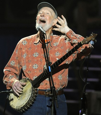 2014seegermag9mg00kwn-1 Pete Seeger is seen her performing during a concert marking his 90th birthday at Madison Square Garden in New York.