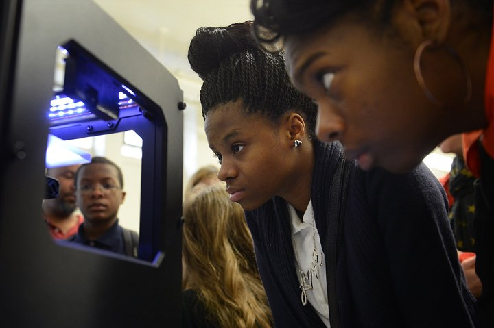 Wilkinsburg Middle School 3-D printer demonstration Eighth-graders Jayla Mason, 13, center, and Lychae Corley, 14, watch a 3-D printer at a demonstration Tuesday at Wilkinsburg Middle School.